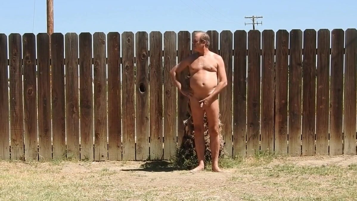 A daddy parading around naked in his backyard. 3